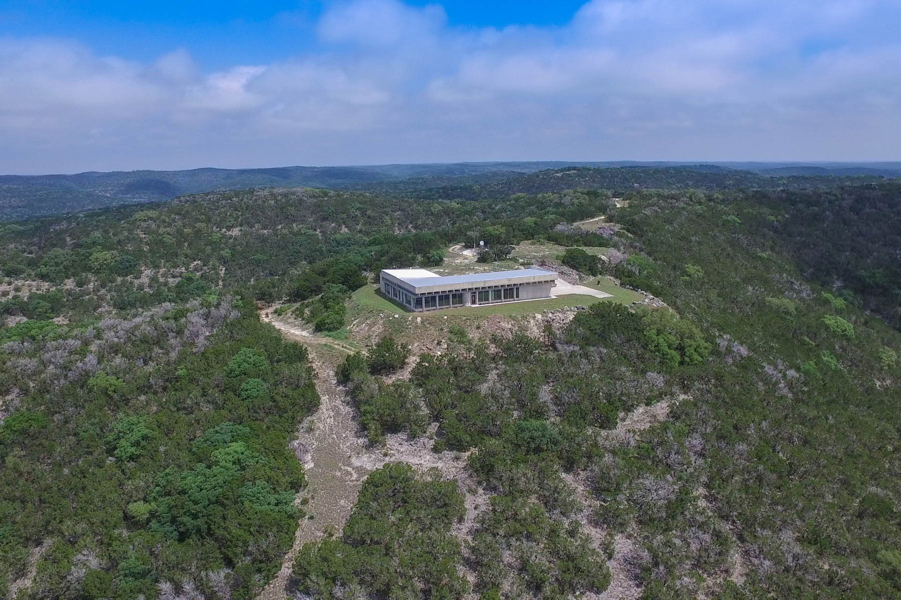 Farm / Ranch / Plantation for Sale at Contemporary Hill Country Retreat on 42 +- Acres 7126 E Ranch Road 337 Leakey, Texas 78873 United States