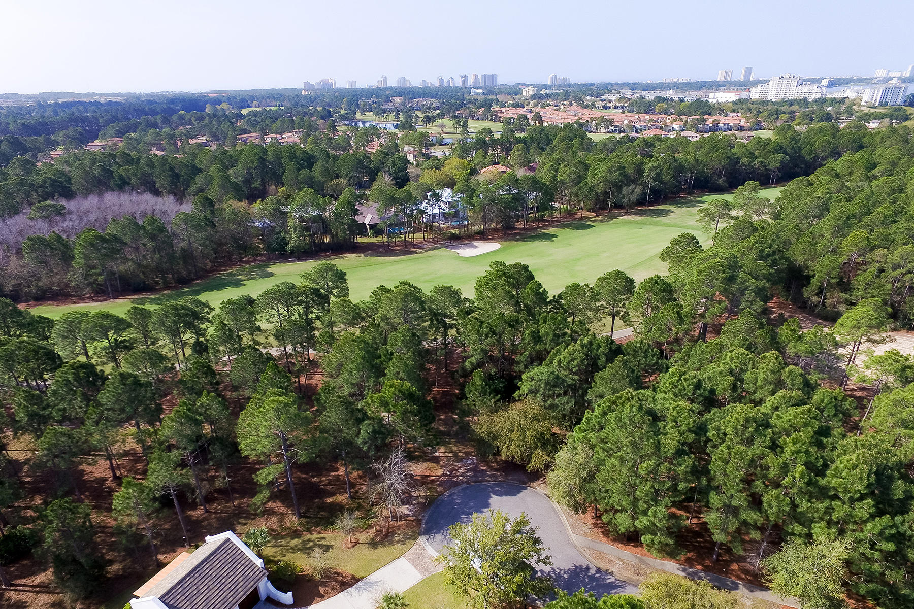 Земля для того Продажа на GENEROUS WOODED LOT WITH FAIRWAY VIEWS 3415 Ravenwood Circle Miramar Beach, Флорида, 32550 Соединенные Штаты