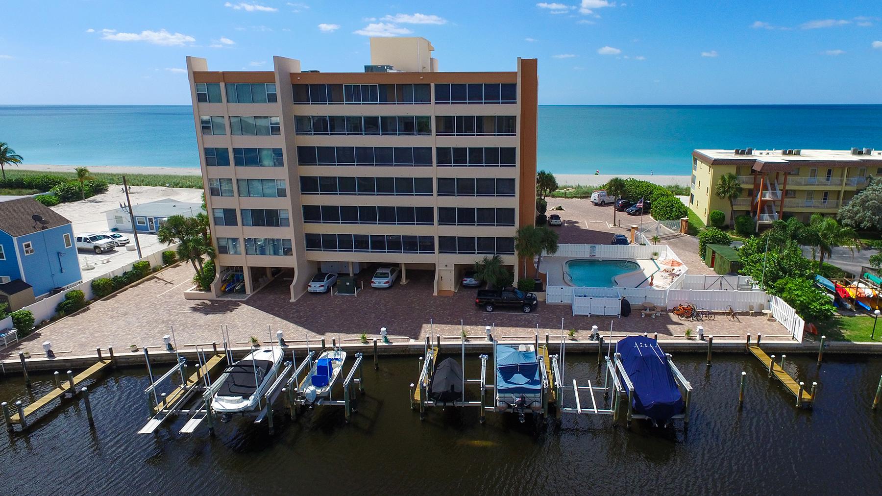 콘도미니엄 용 매매 에 FISHERMAN'S HAVEN 9150 Blind Pass Rd 604 Sarasota, 플로리다, 34242 미국