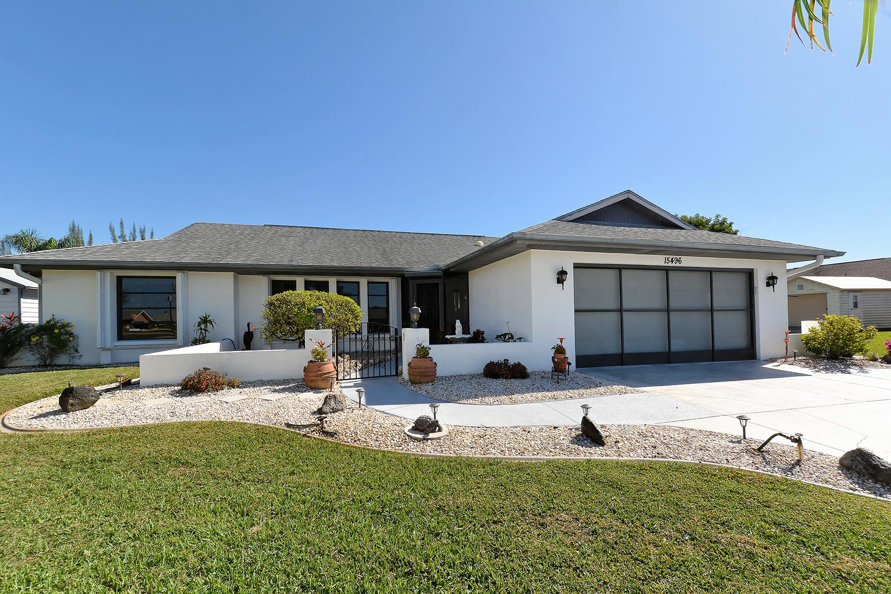 Nhà ở một gia đình vì Bán tại SOUTH GULF COVE 15496 Avery Rd Port Charlotte, Florida, 33981 Hoa Kỳ