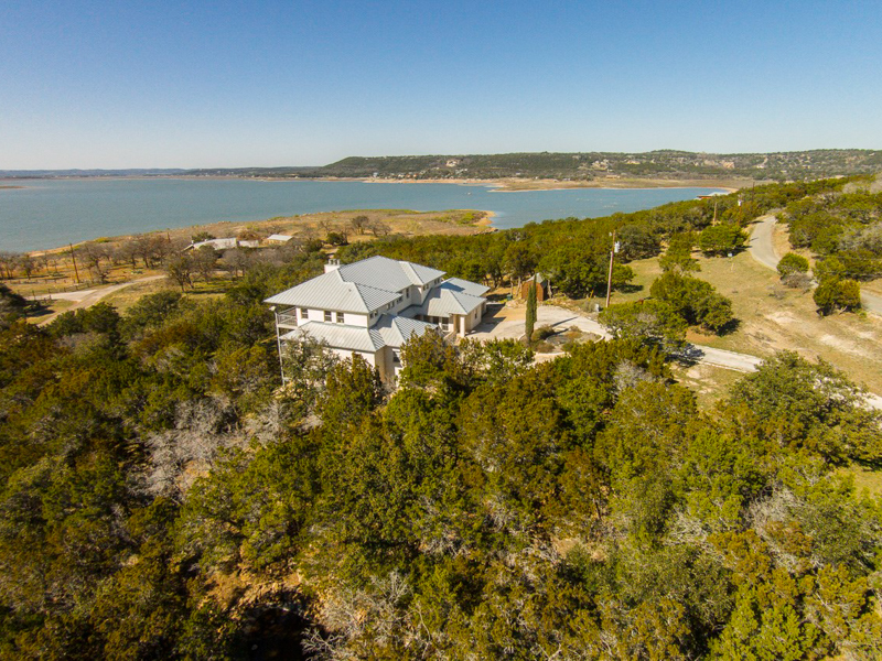 Villa per Vendita alle ore 3-Story Lake Buchanan Home with Great Views 4401 Sunset Cliff Burnet, Texas 78611 Stati Uniti
