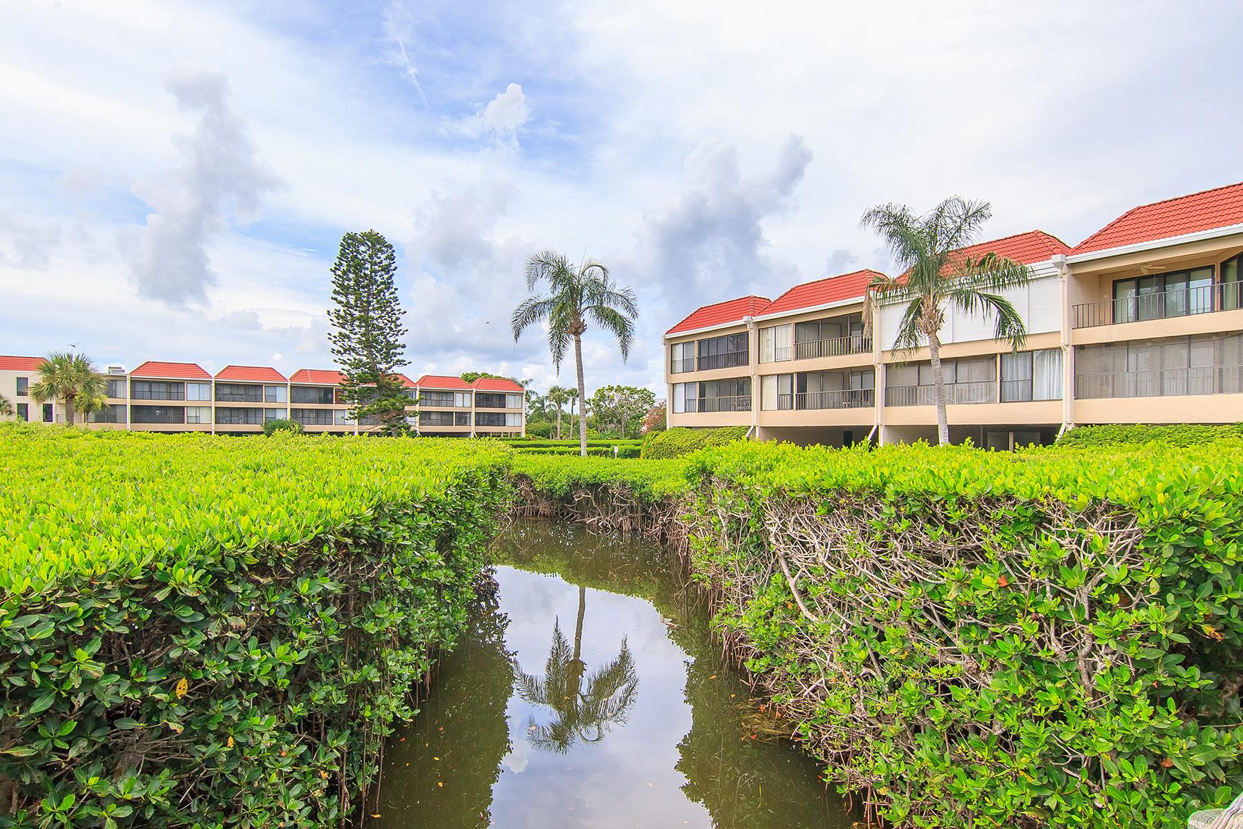 Condomínio para Venda às HOLMES BEACH 3805 E Bay Dr 305 Holmes Beach, Florida 34217 Estados Unidos