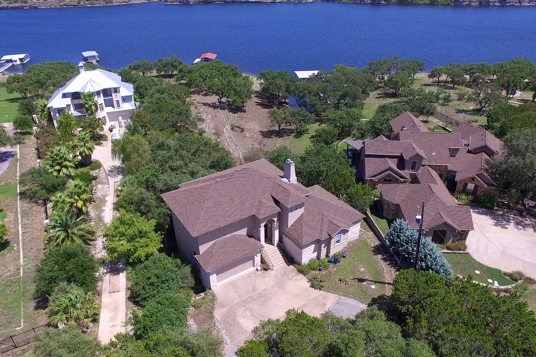 Single Family Home for Sale at Lake Travis Waterfront Paradise 23516 Paradise Cv Marble Falls, Texas, 78654 United States