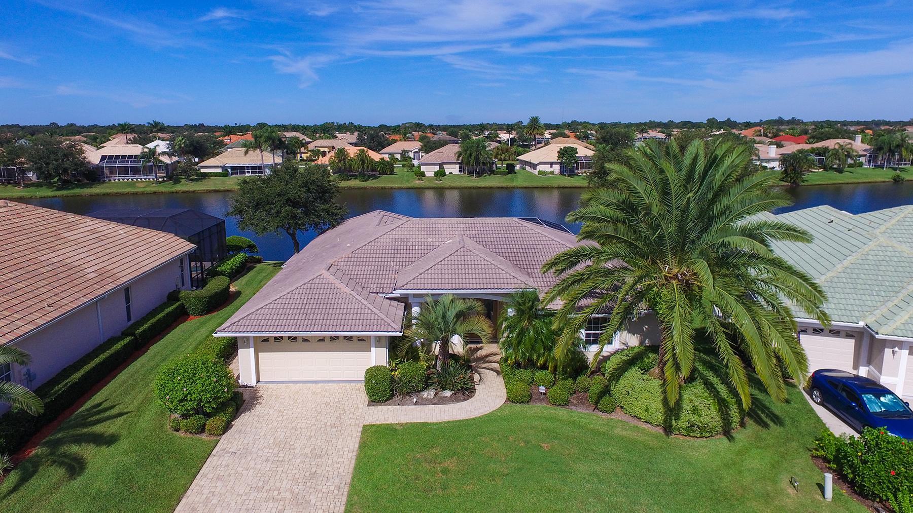 Vivienda unifamiliar por un Venta en LAUREL LAKES 8343 Barton Farms Blvd Sarasota, Florida, 34240 Estados Unidos