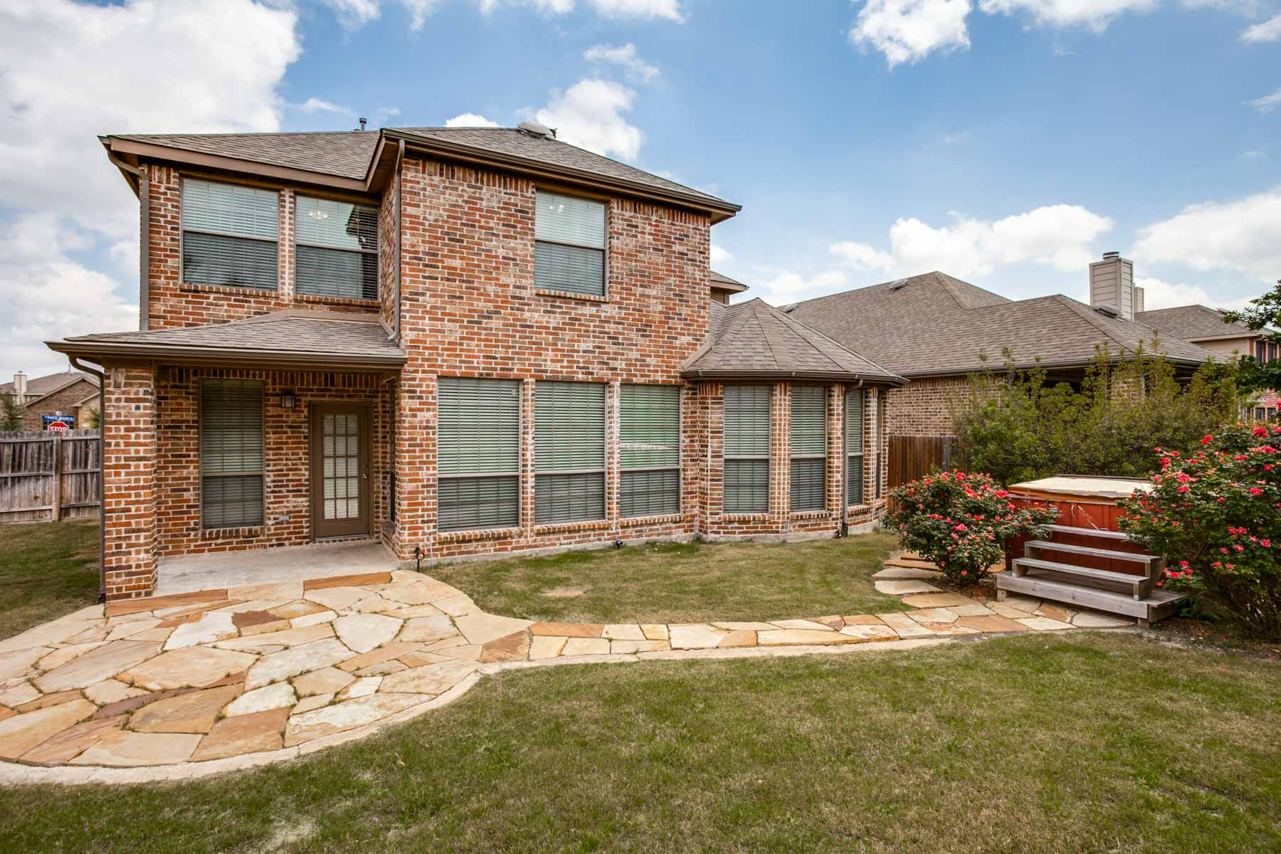 Single Family Home for Sale at Welcoming Woodcreek Home 625 Fate Main Pl Rockwall, Texas 75087 United States