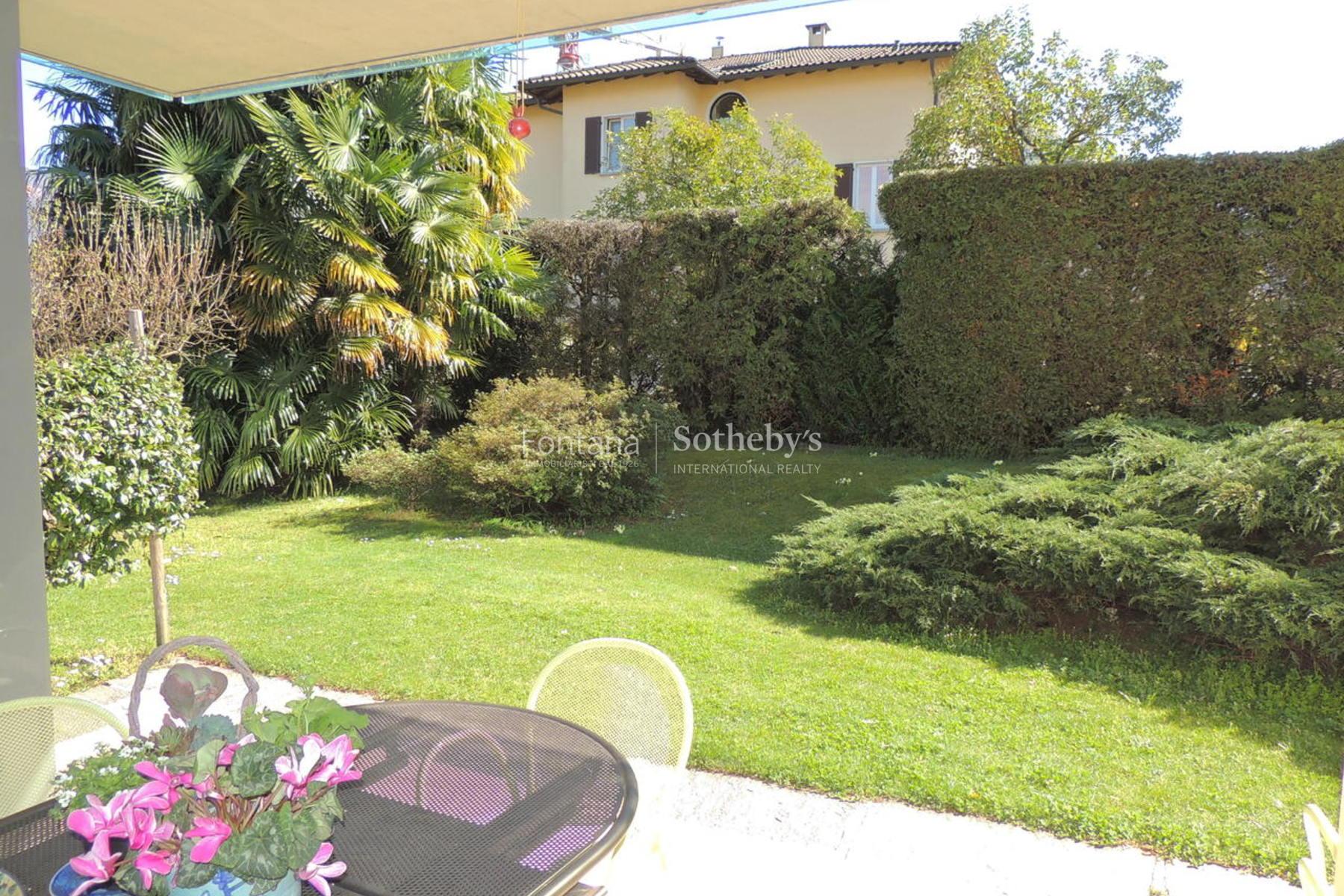 Apartment for Sale at Bright apartment with private garden Gentilino Gentilino, Ticino 6925 Switzerland