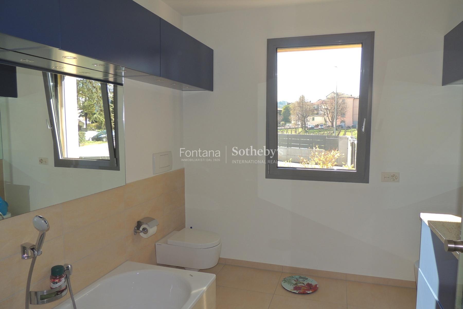 Additional photo for property listing at Bright apartment with private garden Gentilino Gentilino, Ticino 6925 Switzerland
