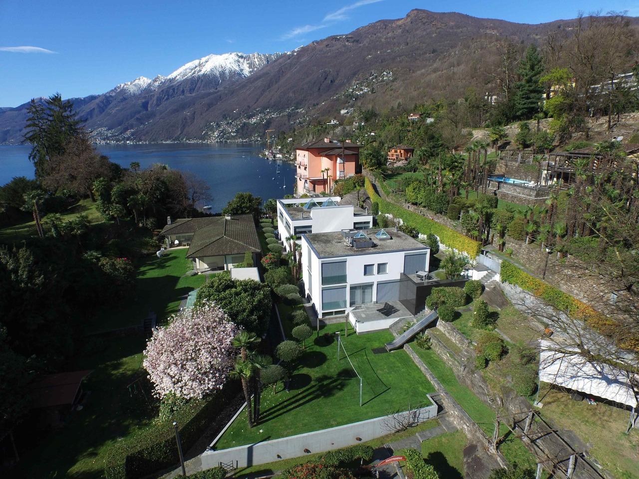 Single Family Home for Sale at Great contemporary villa with private beach, pool and guest house Ascona Locarno, Ticino 6600 Switzerland