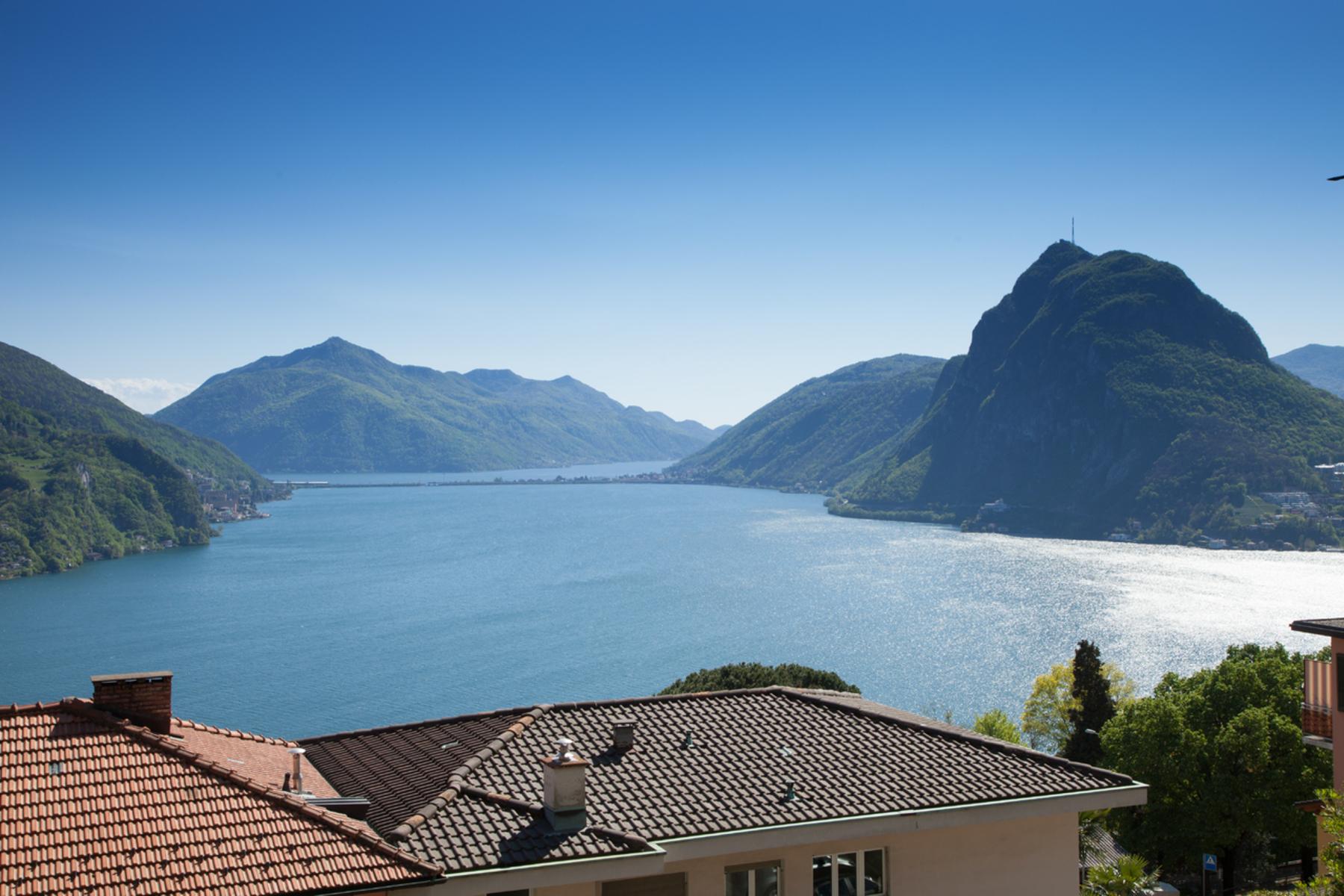 شقة للـ Sale في Exclusive flat with lake view Ruvigliana, Ruvigliana, Ticino, 6977 Switzerland