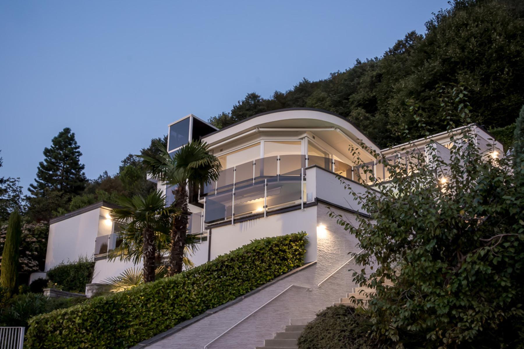 واحد منزل الأسرة للـ Sale في Elegant villa with splendid lake view Lugano - Aldesago, Aldesago, Ticino, 6974 Switzerland
