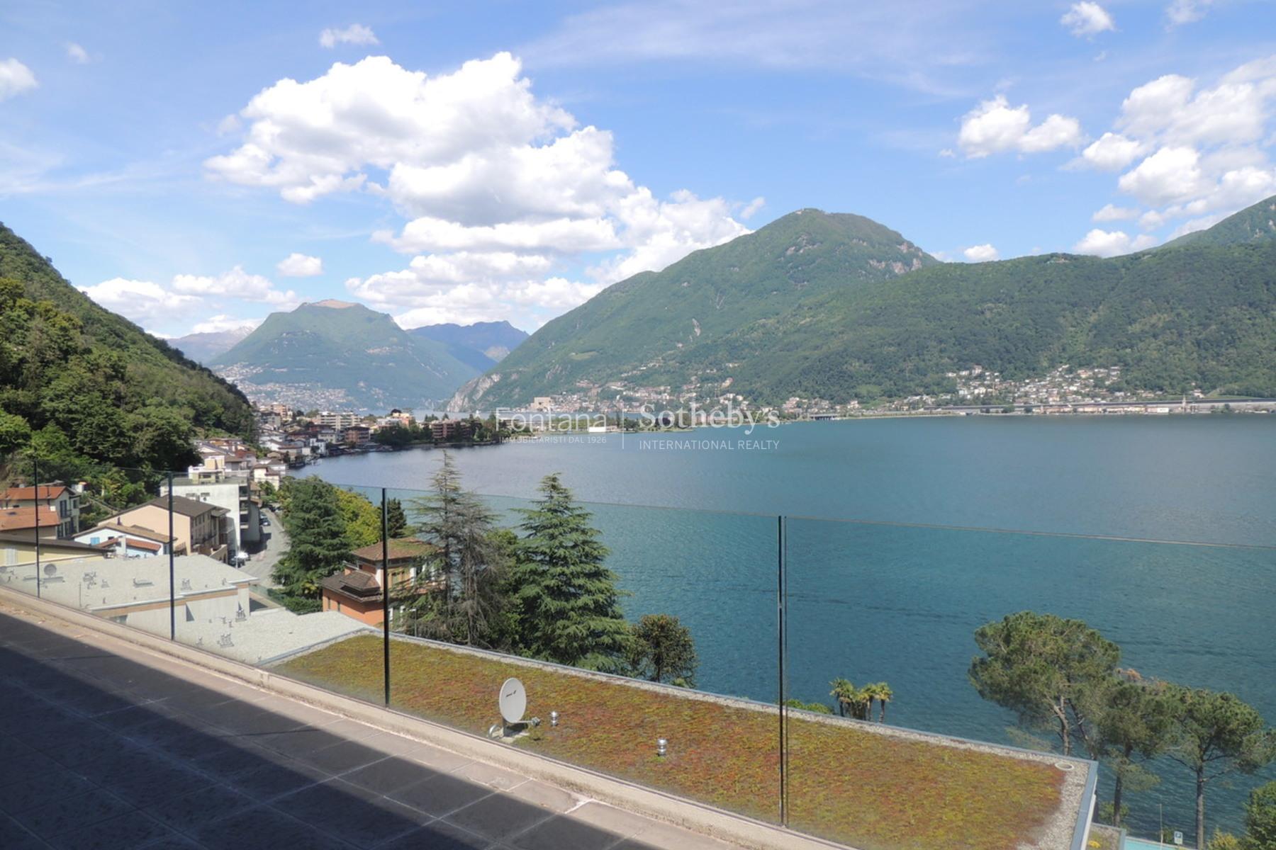 Квартира для того Продажа на Modern duplex penthouse with magnificent lake view - a real Bijoux! Melide Melide, Ticino, 6815 Швейцария