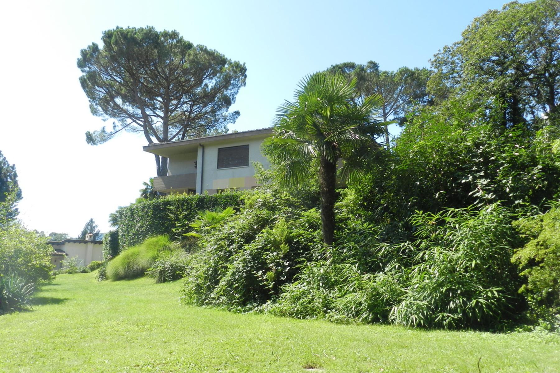 Частный односемейный дом для того Продажа на Family house in the green with large garden Origlio, Other Switzerland, Другие Регионы В Швейцарии, 6945 Швейцария