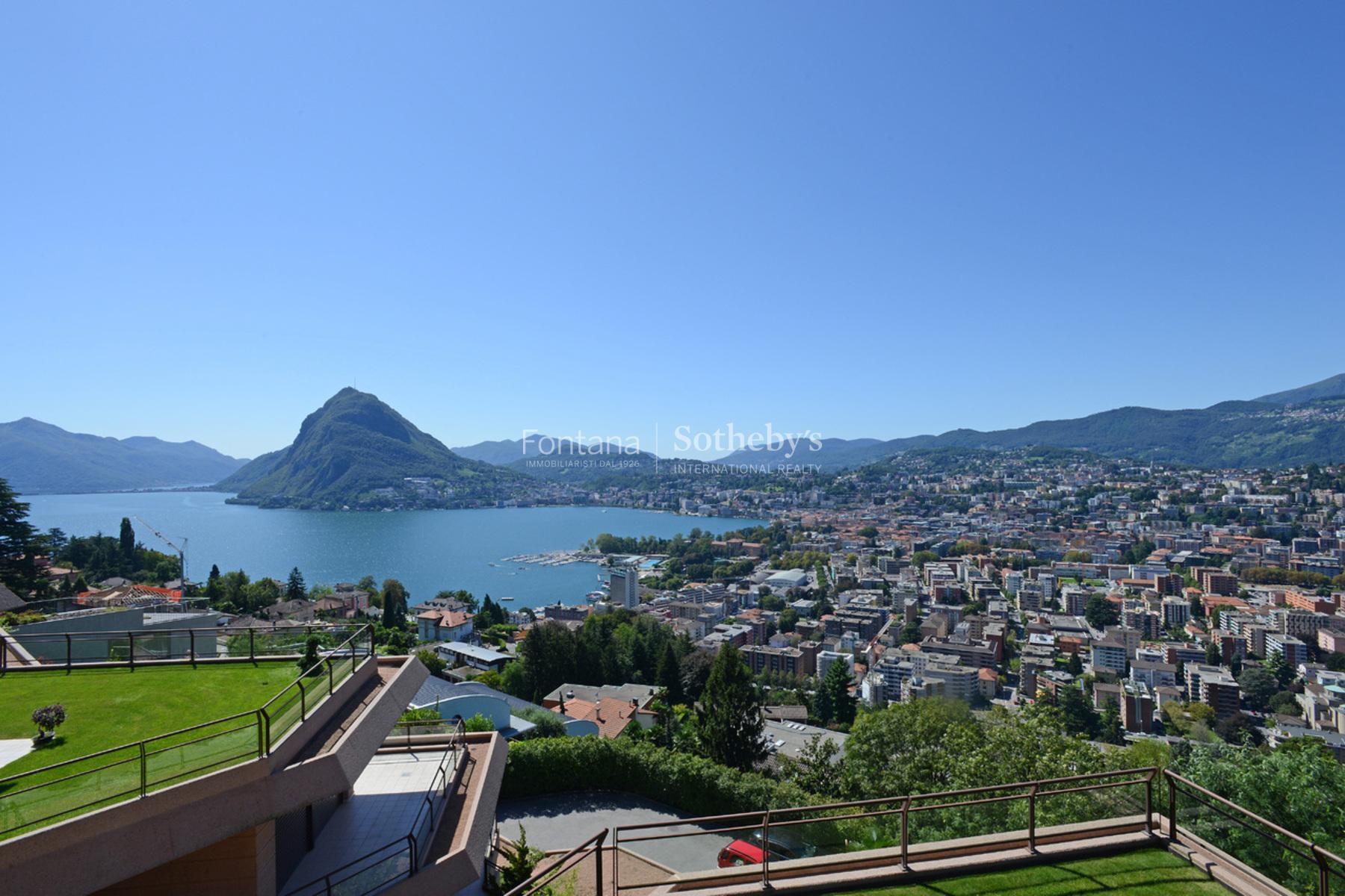 Appartement pour l Vente à Beautiful penthouse with roof garden Ruvigliana Ruvigliana, Ticino, 6977 Suisse