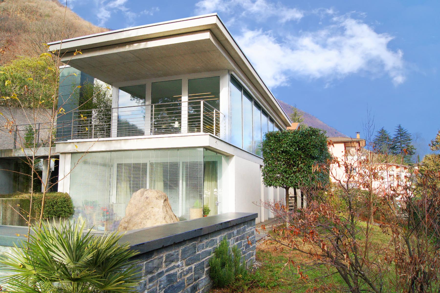 Casa Unifamiliar por un Venta en Design villa with panoramic view Riva San Vitale, Riva San Vitale, Ticino, 6826 Suiza