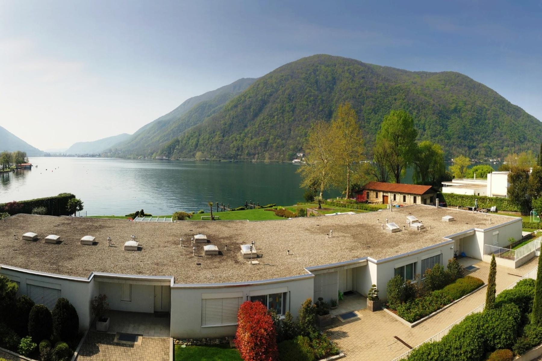 Apartments por un Venta en Modern lake front penthouse with large terrace Melano Other Ticino, Tesino 6818 Suiza