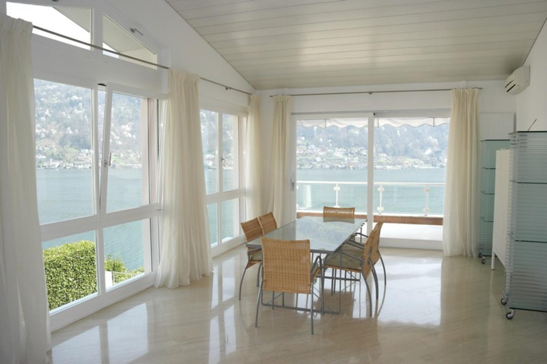 Apartment for Sale at Prestigious mini attic with separate dependance Morcote, Morcote, Ticino, 6922 Switzerland