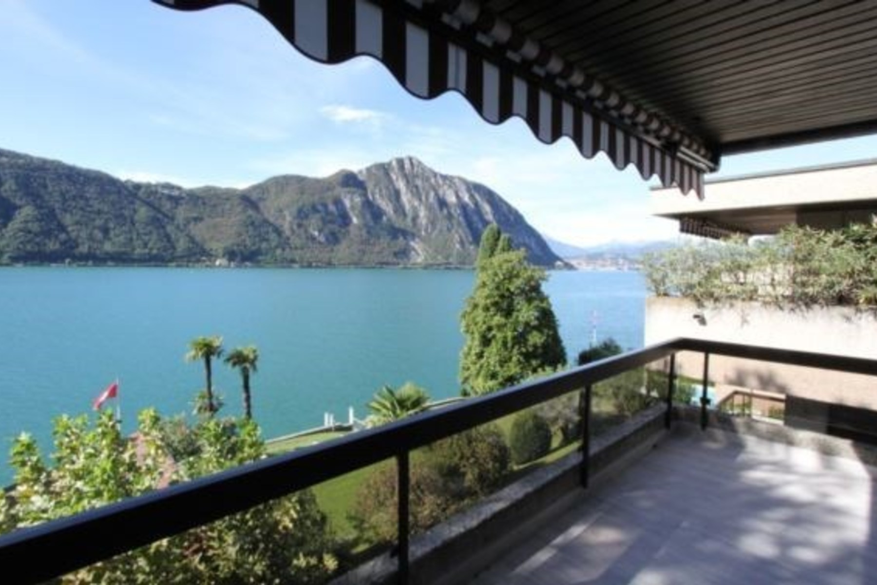 Apartment for Sale at Modern penthouse with lake view in Bissone Bissone, Ticino, 6816 Switzerland