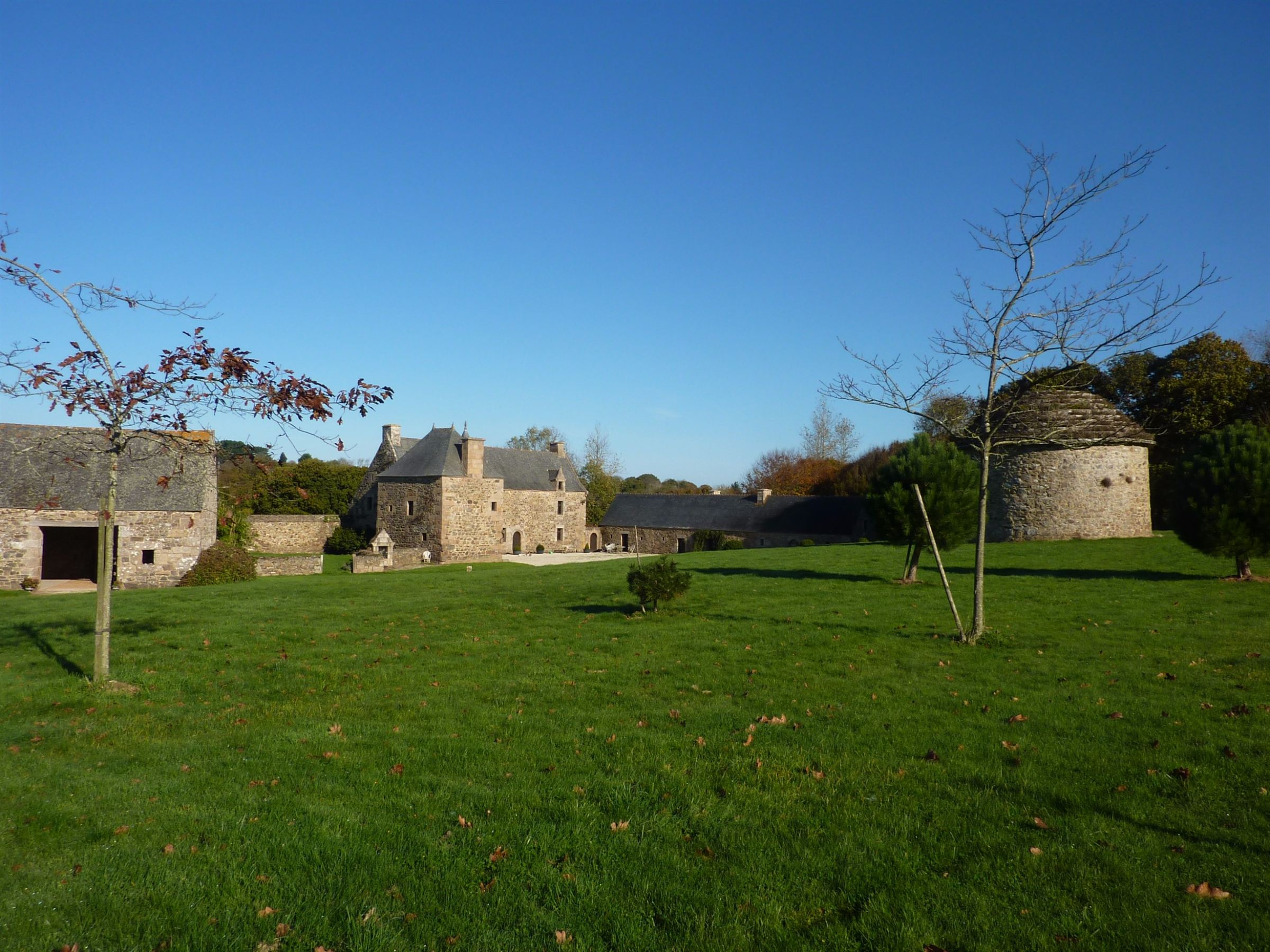 sales property at Listed Manor + outbuildings set on 135 acres near the Pink Granite Coast.