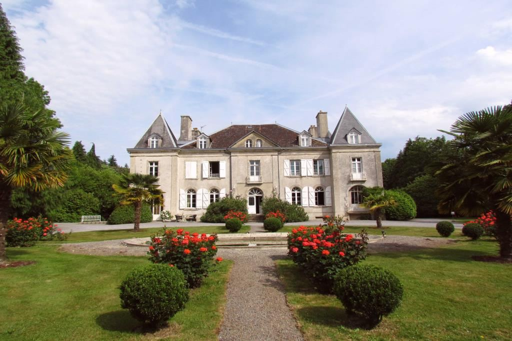 Property For Sale at 19th century castle in South Britanny, dependences, swimming pool.