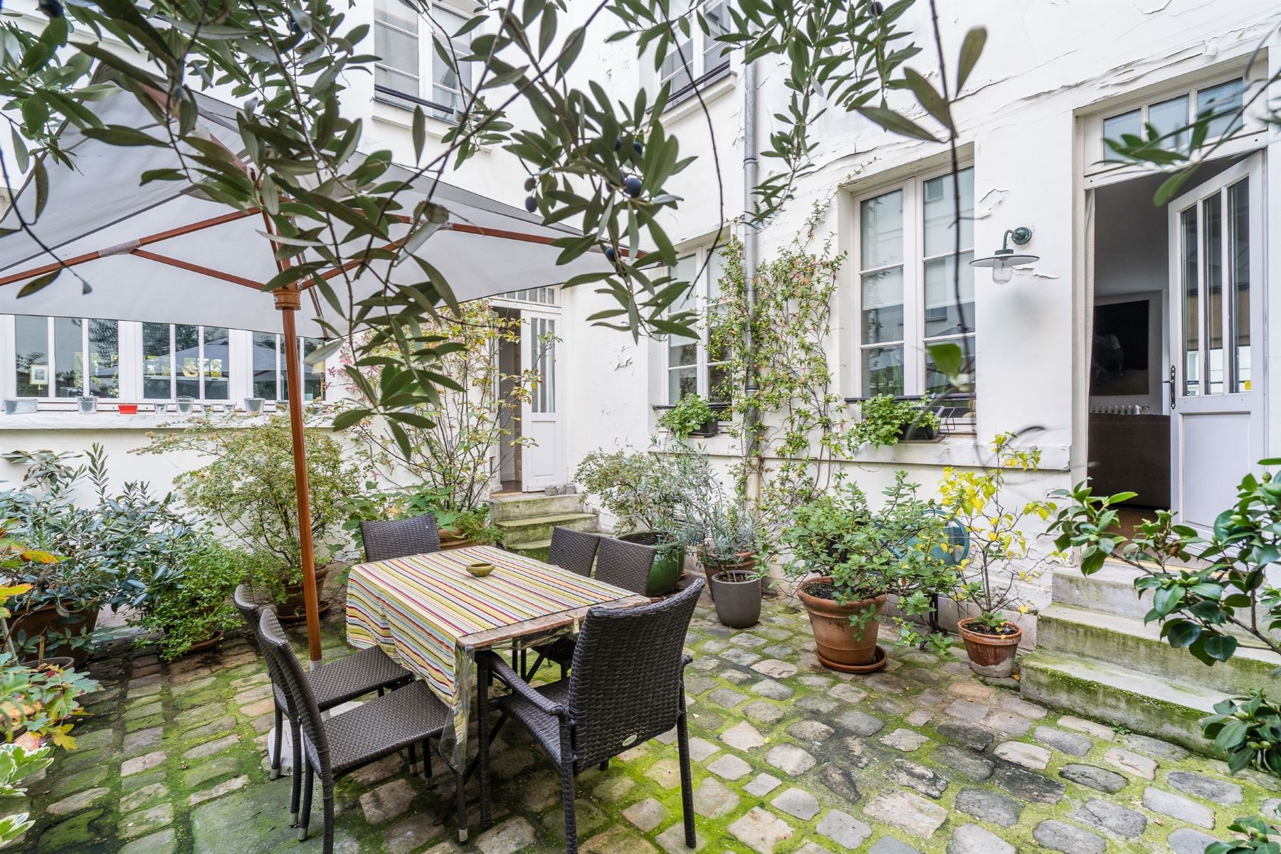 Duplex Homes for Sale at Buttes Chaumont : A family duplex apartment in an absolute peaceful environment Paris, Ile-De-France 75010 France