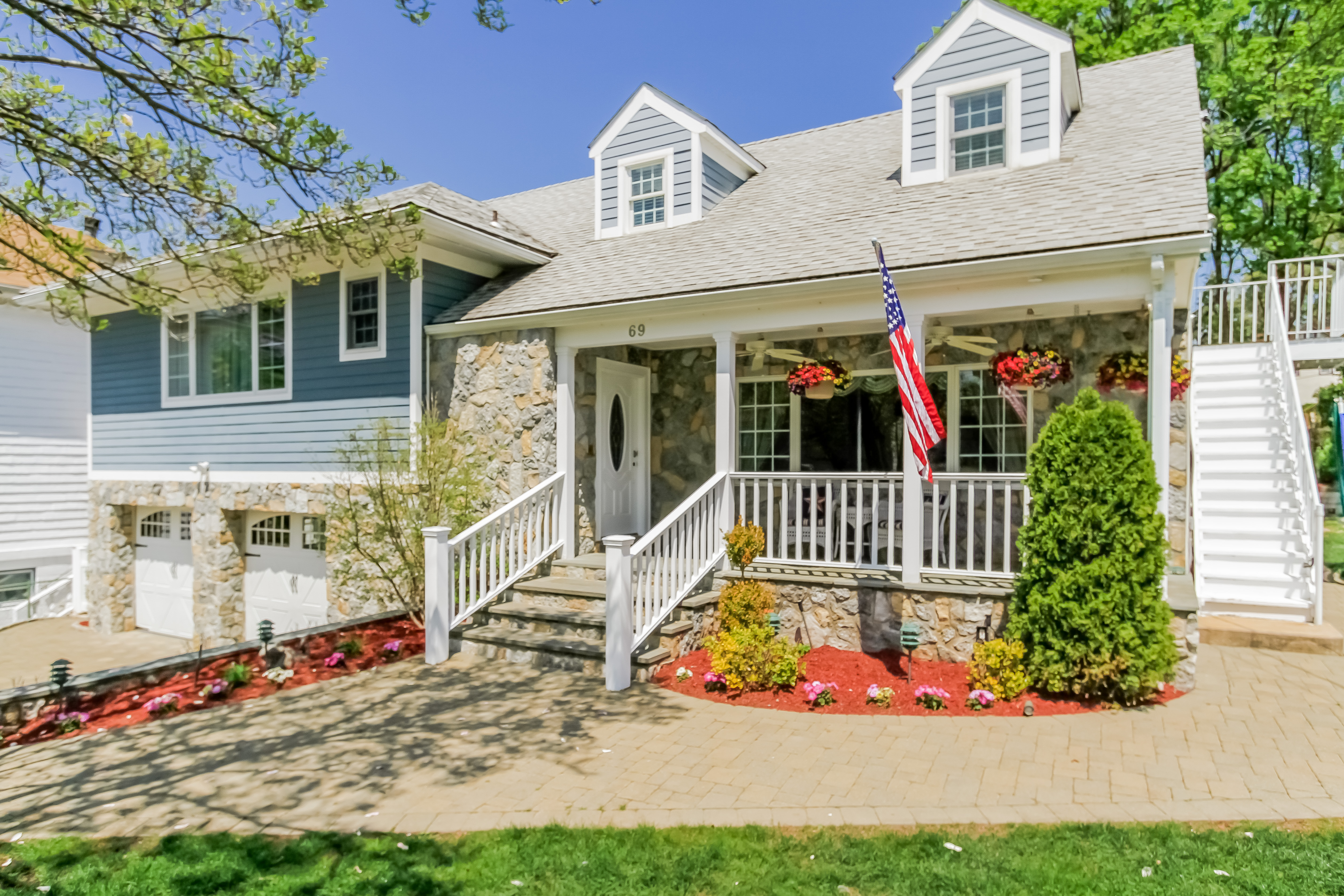 Single Family Home for Sale at Tastefully Renovated Tri-Level Home 69 Woodruff Avenue Scarsdale, New York 10583 United States