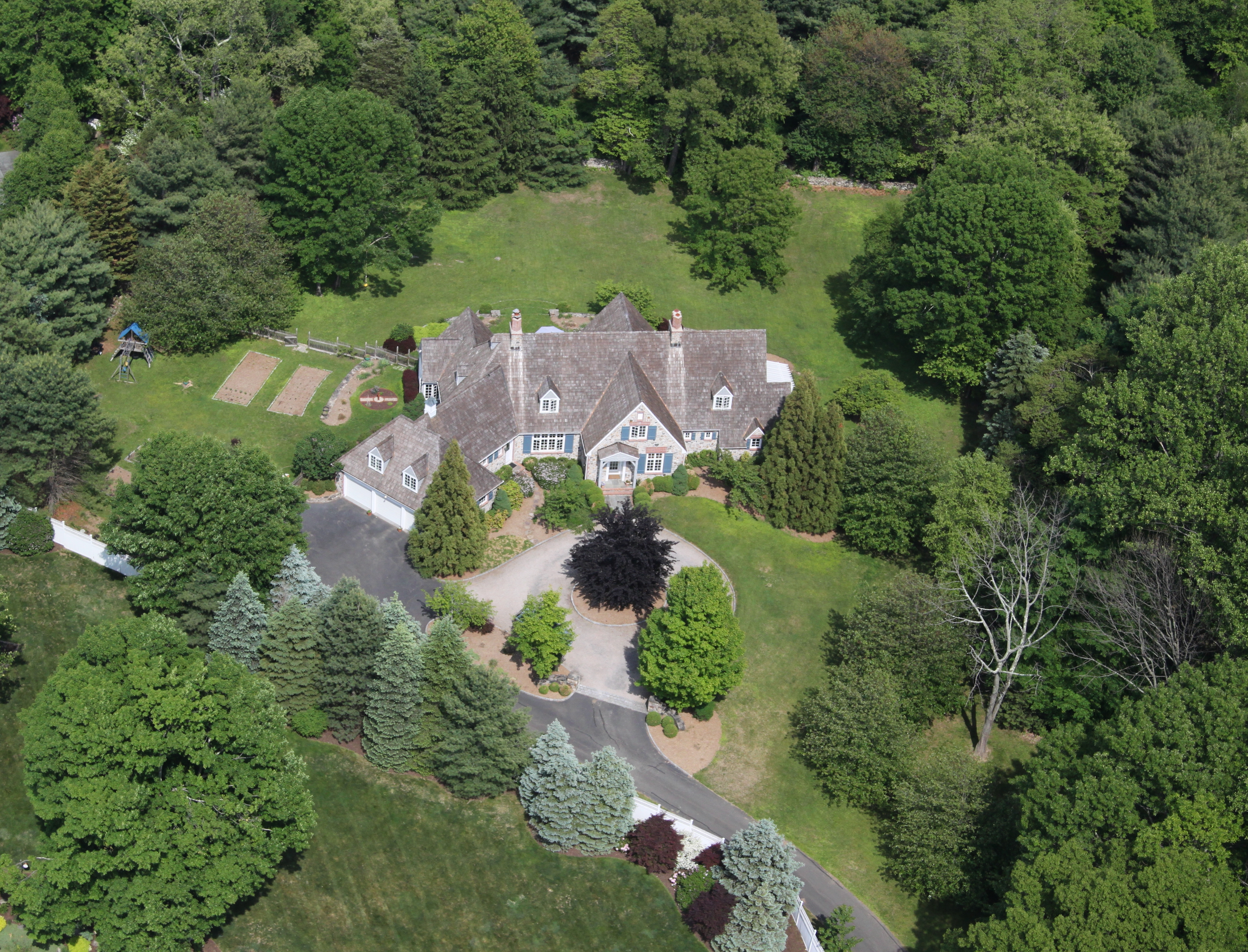 sales property at Spectacular Stone & Shingle Estate