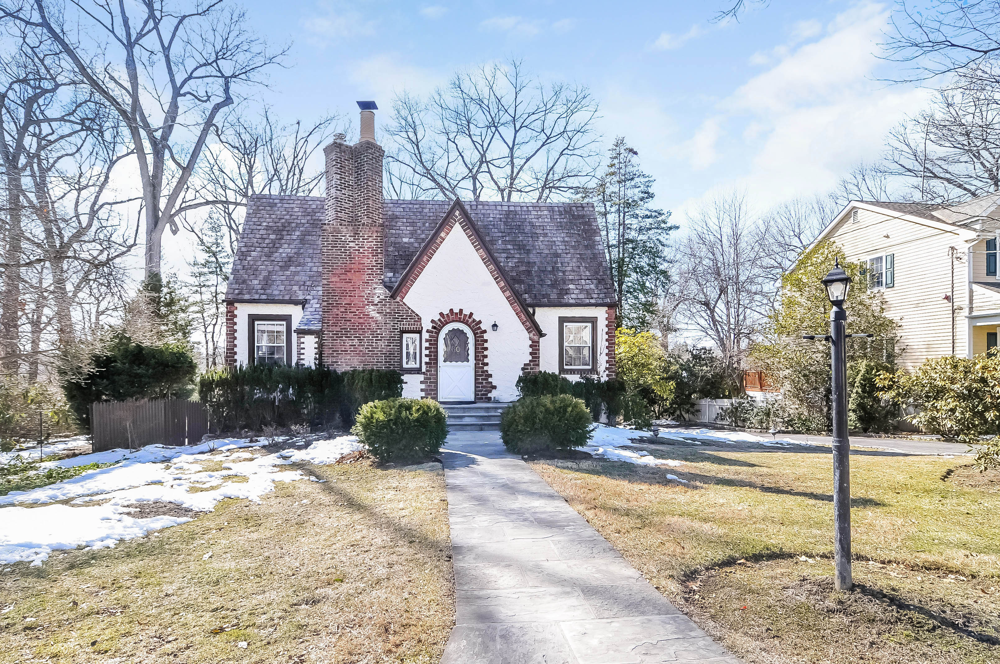 Single Family Home for Sale at Sunny and Charming Tudor 60 Carthage Road Scarsdale, New York 10583 United States