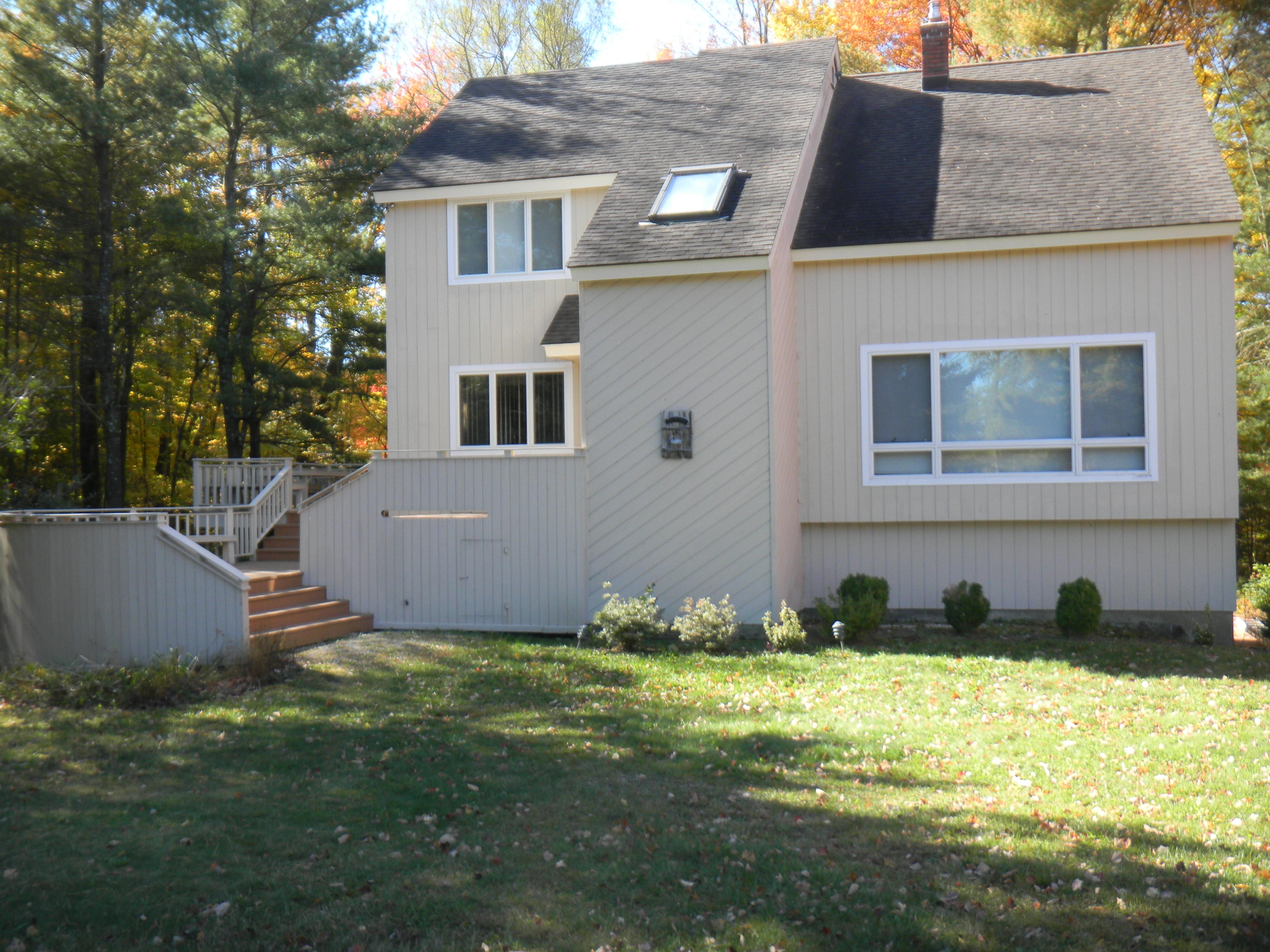 sales property at Woodridge Lake Cotemporary + Waterfront Lot