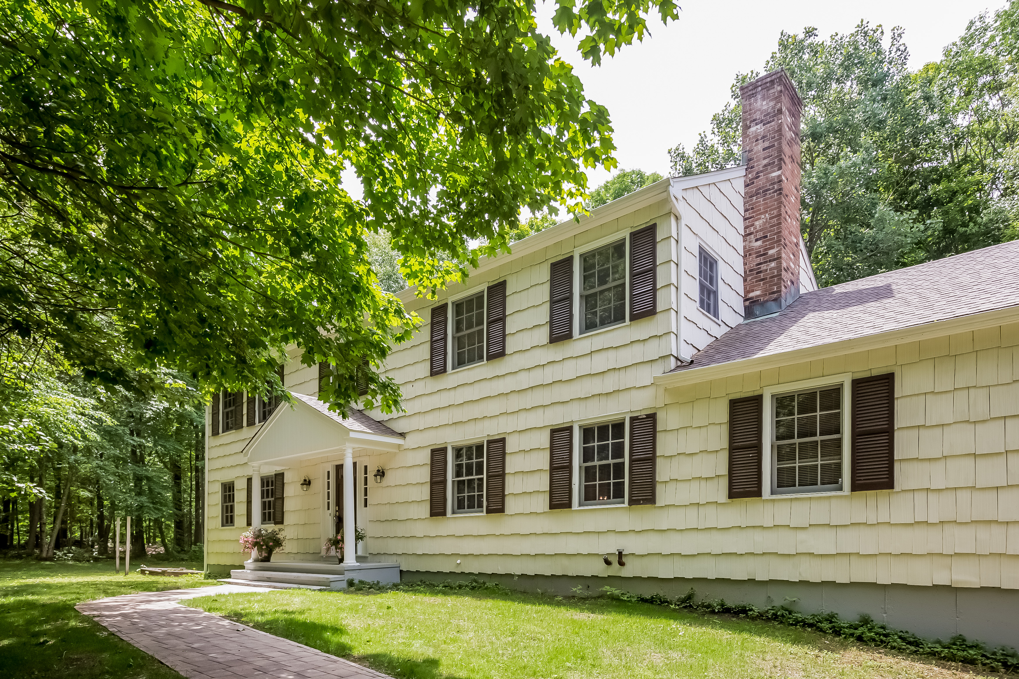 sales property at Spacious Colonial Nestled In A Tranquil Sylvan Setting