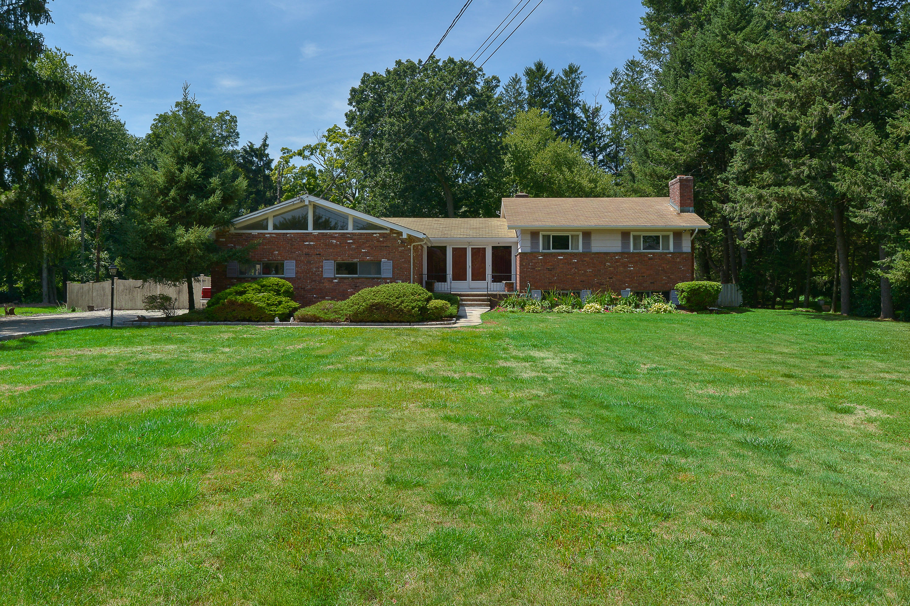 Single Family Home for Sale at North Stamford Split Level 66 Hoyclo Road Stamford, Connecticut, 06903 United States