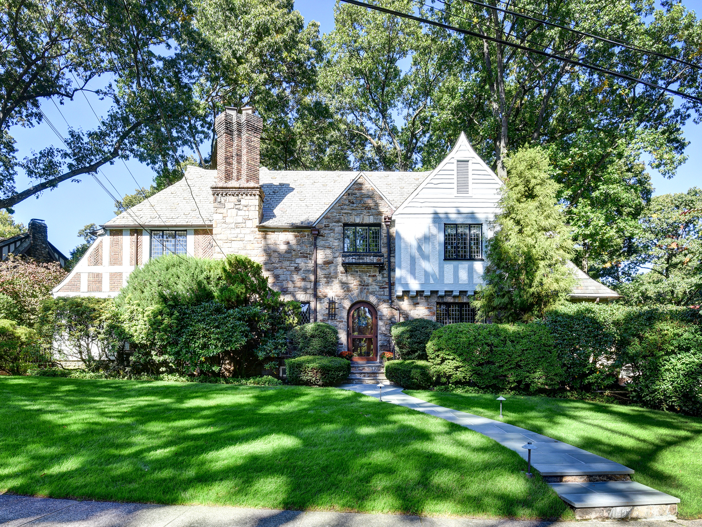 sales property at Walkable, Updated, Sun-Drenched Tudor