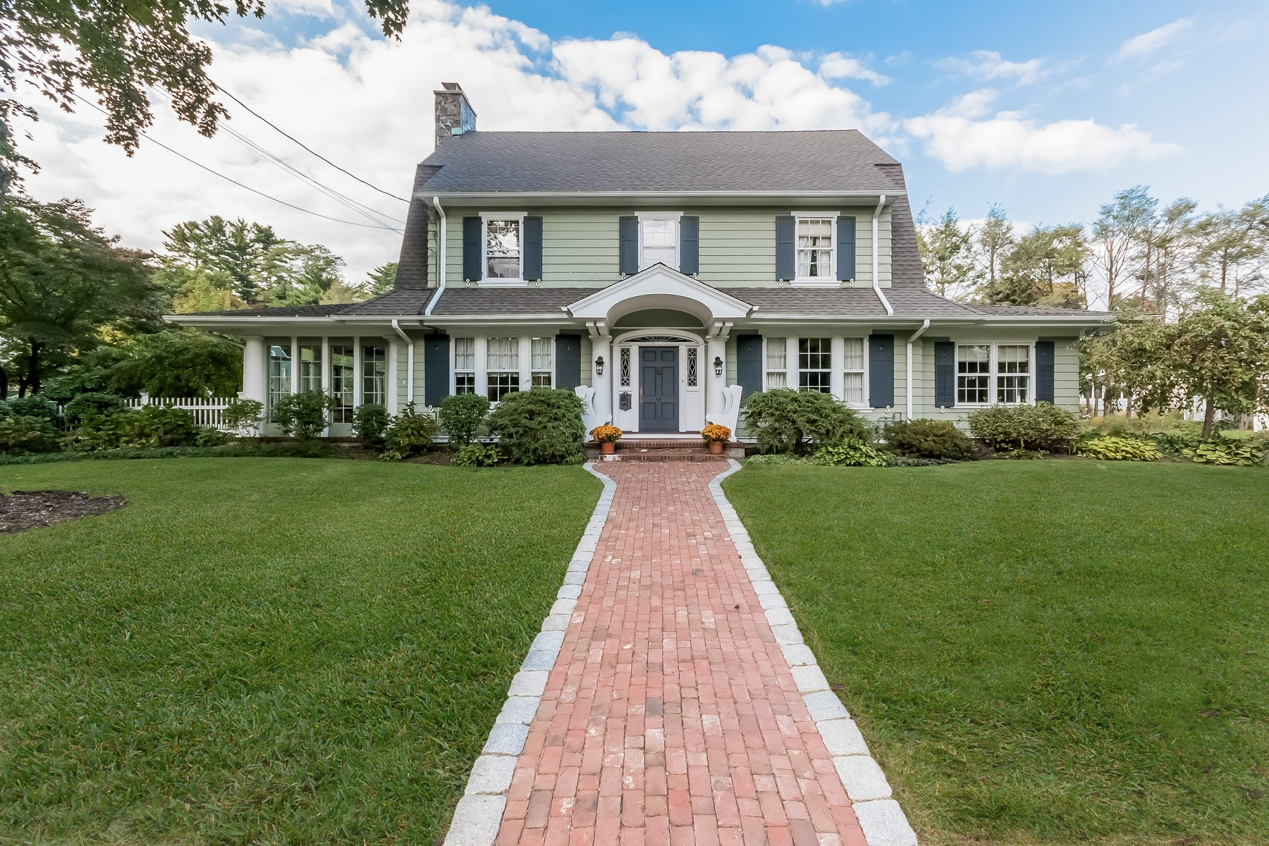 Property For Sale at Quintessential Dutch Colonial in Picturesque Country Club Neighborhood