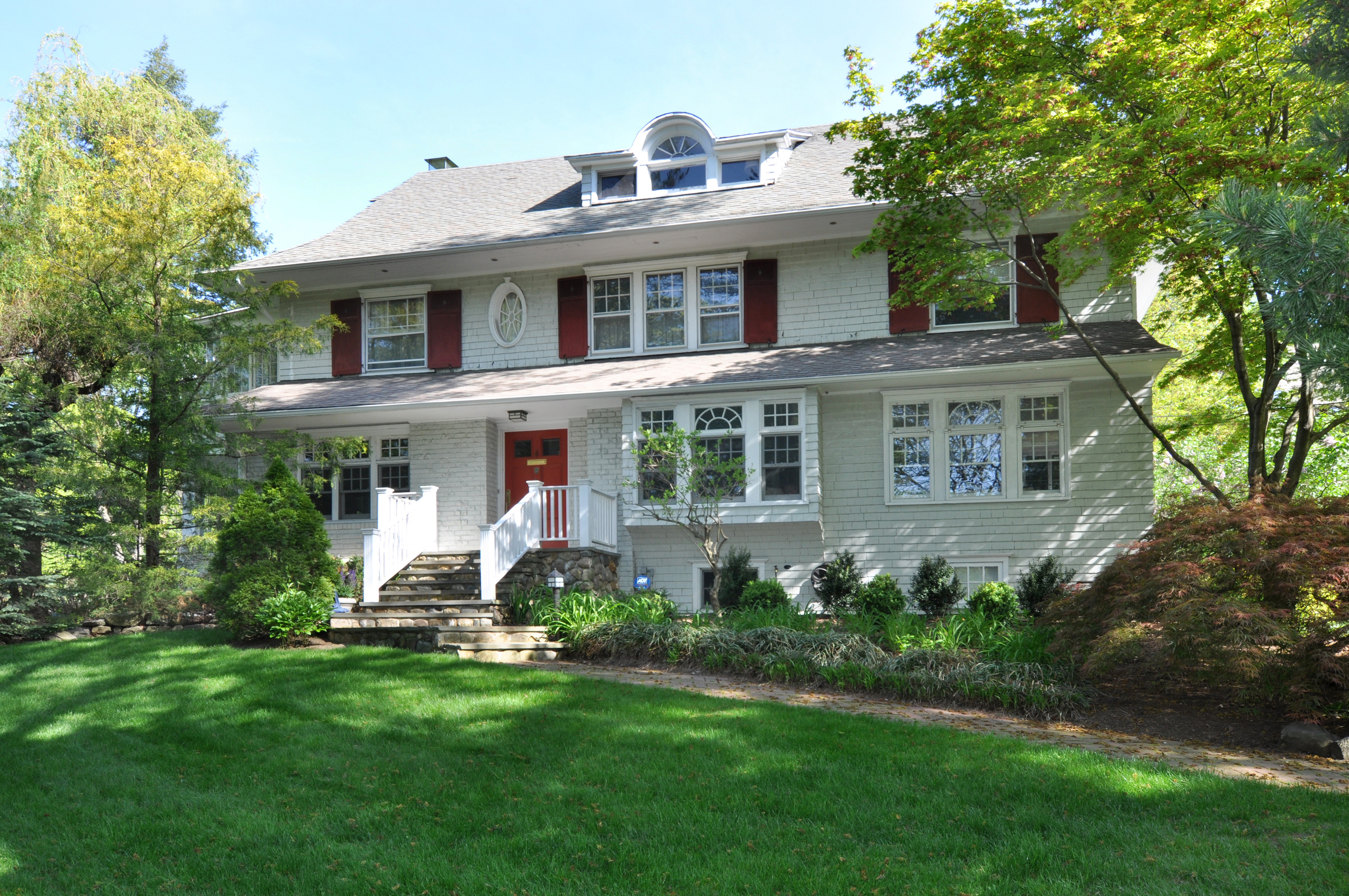 sales property at Picturesque Pelham Manor Colonial