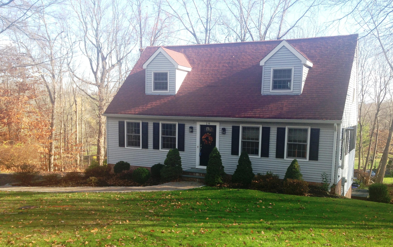 Maison unifamiliale pour l Vente à Captivating Country Cape 19 Evergreen Place Ridgefield, Connecticut 06877 États-Unis