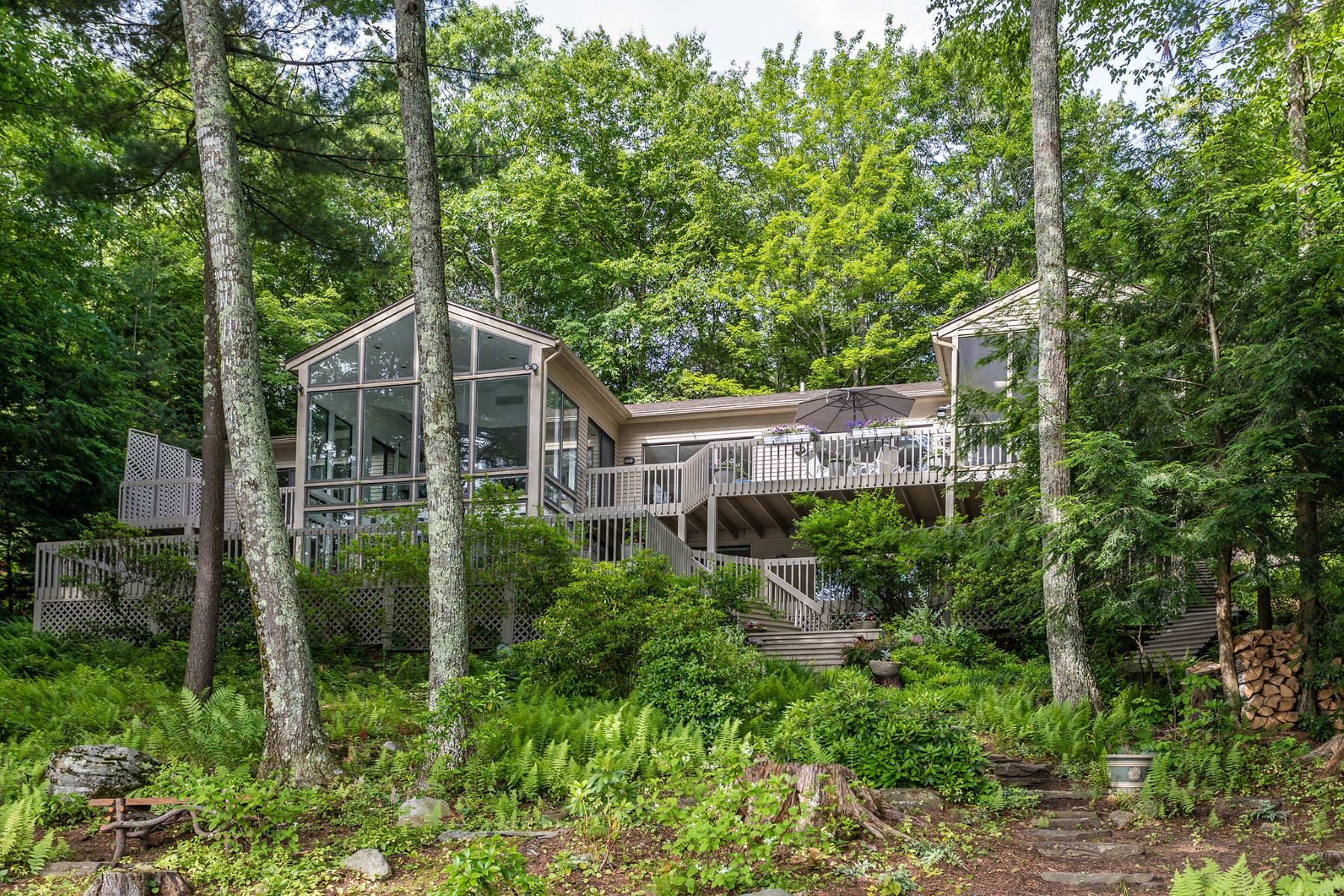 Single Family Homes للـ Sale في Woodridge Lake Waterfront Home 219 West Hyerdale Drive, Goshen, Connecticut 06756 United States