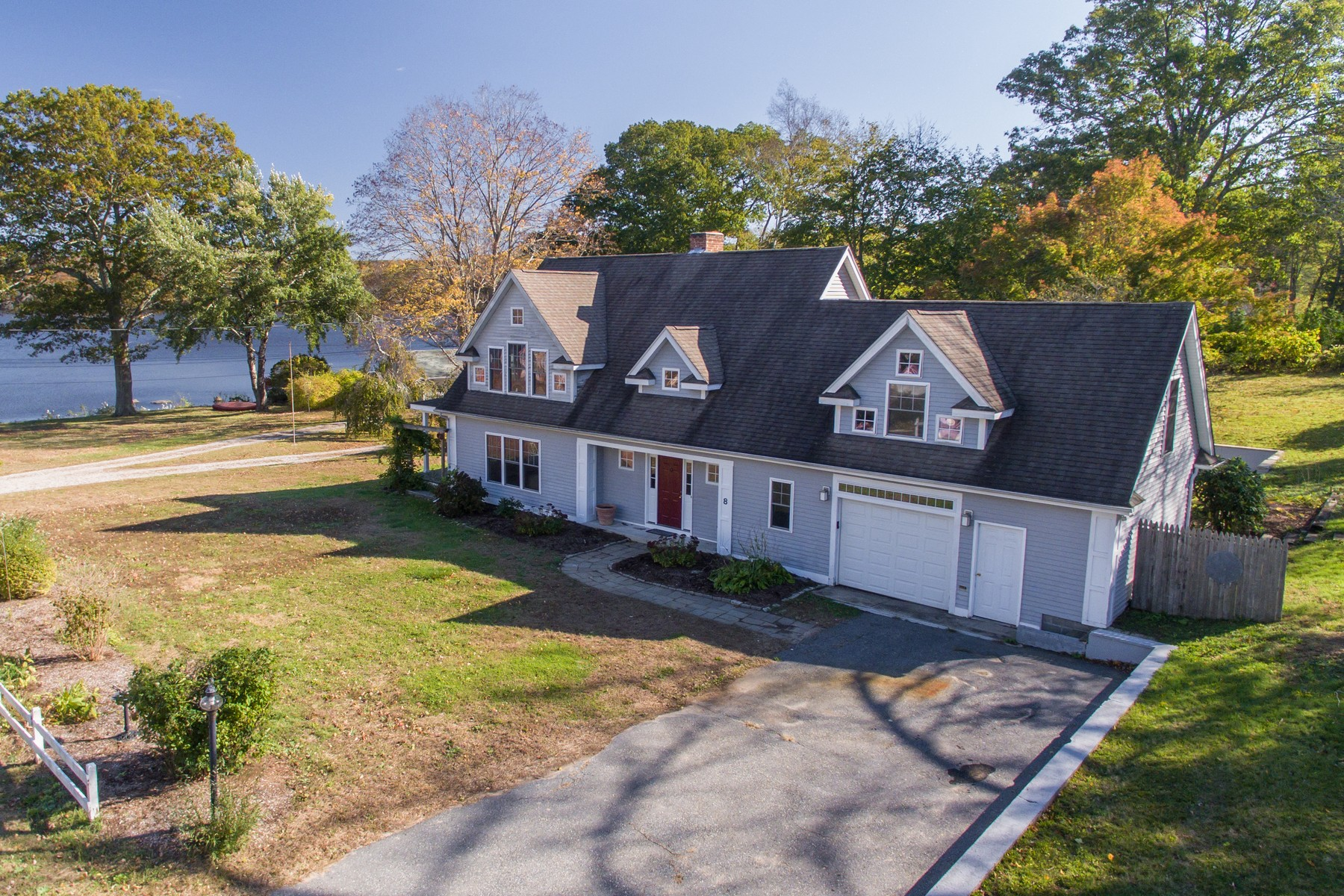Single Family Homes for Sale at Beautiful Light-Filled Home 8 South Cove Lane Essex, Connecticut 06426 United States