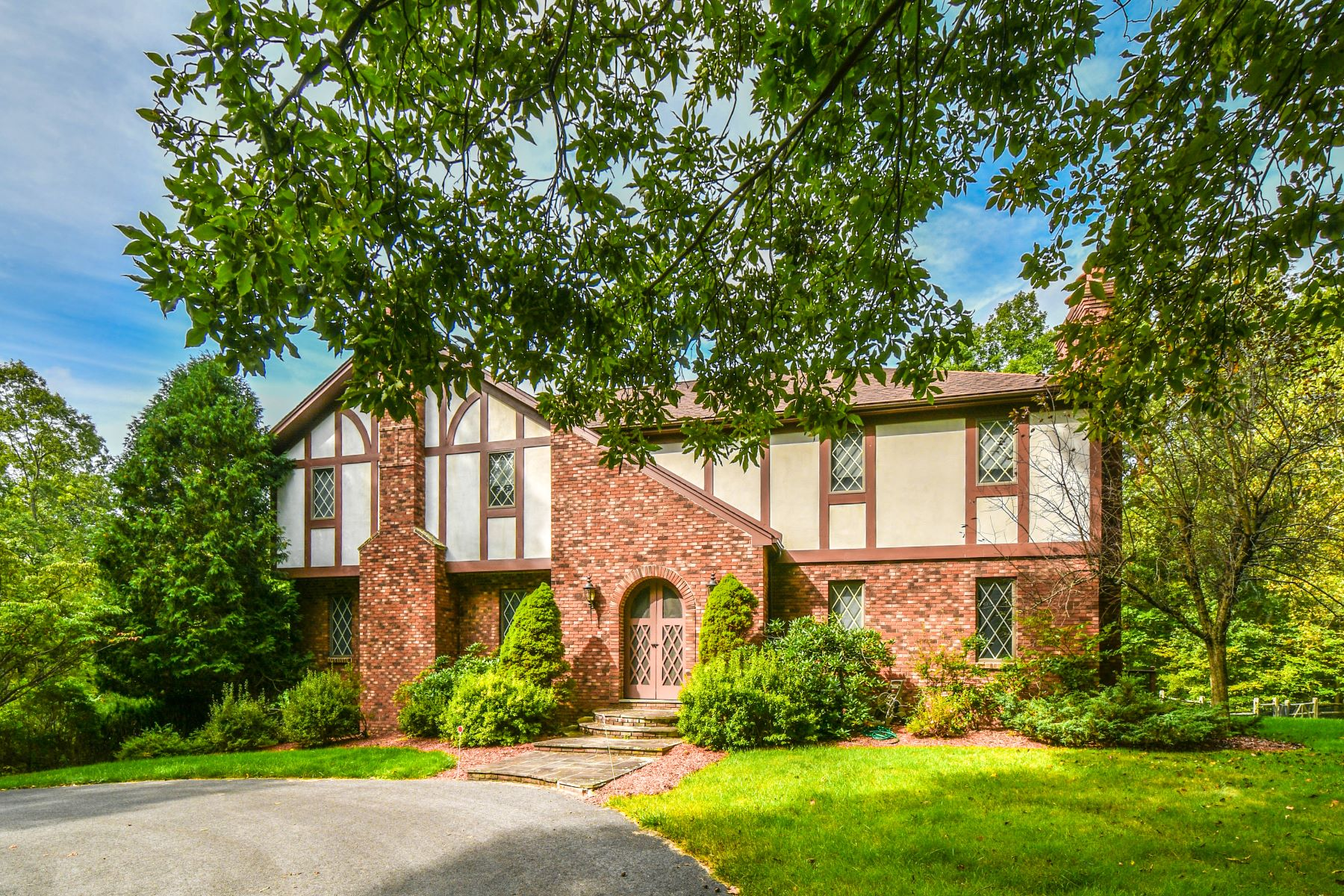 Single Family Home for Sale at Stately Tudor on Fourteen Tranquil Acres 26 Rockledge Lane New Milford, Connecticut 06776 United States