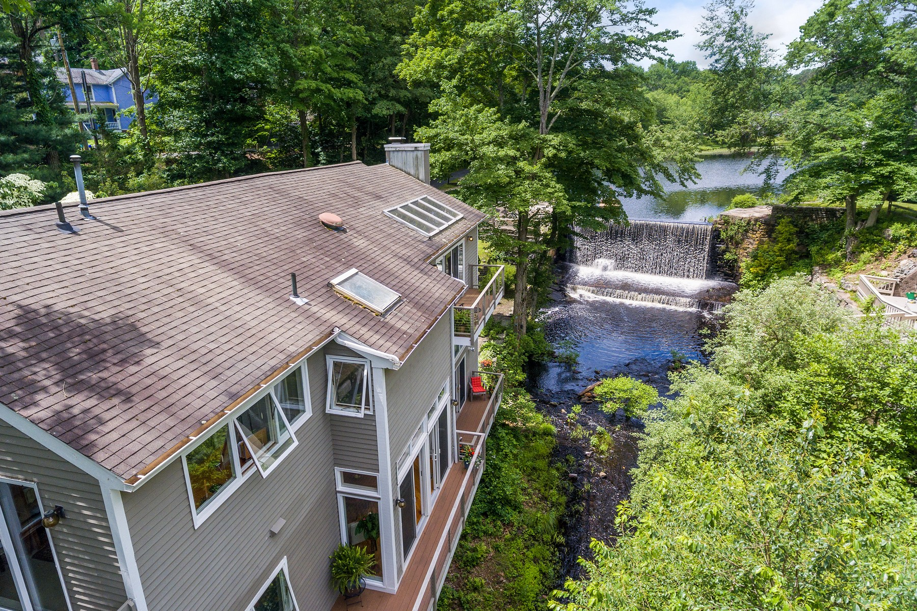 Single Family Homes for Sale at Sun-Filled Contemporary in Beautiful Setting 26 Spring Street Chester, Connecticut 06412 United States